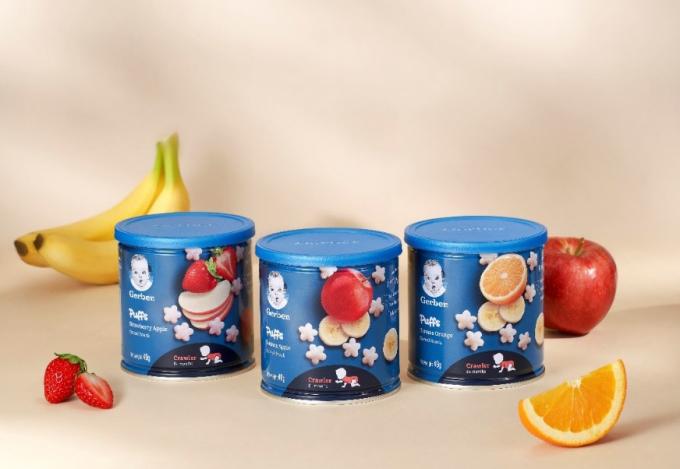 Bánh ăn dặm Gerber Puffs bổ sung thêm vitamin B1, kẽm; bao bì hộp thiếc mới. Ảnh: Gerber.